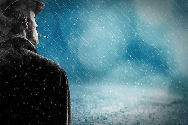 Мужчина под дождем